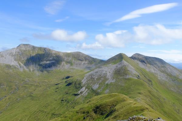 Photo of Looking back whilst ascending Stob Coire a Chairn. Na Gruagaichean's twin peaks on right with Binnein Mor on left